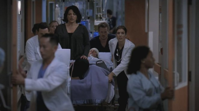 """Callie's """"spirit"""" sits on top of her body as she is rushed by the doctors to the O.R."""