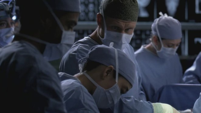 Owen assists Christina in Callie's surgery