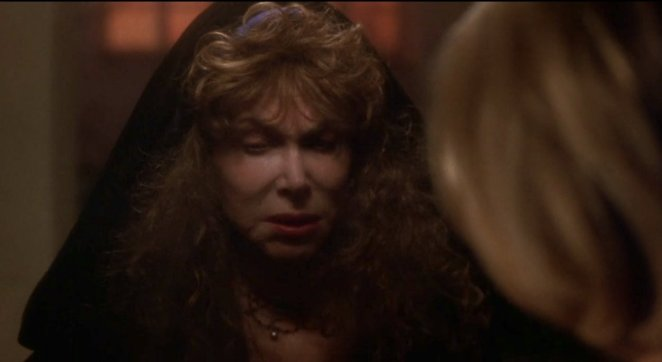 Louise, the neighbor in Mulholland Drive, warning Betty.