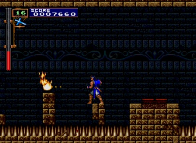 Richter stands on a tiny platform, surrounded by pits of spikes.