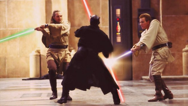 Qui-Gon Jinn and Obi-Wan Kenobi battle it out with Darl Maul using lightsabers on Naboo
