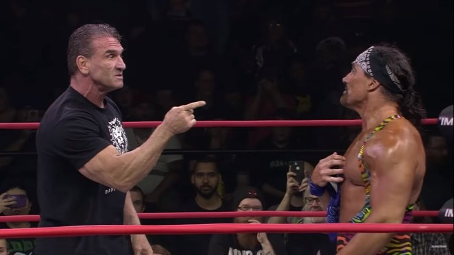 Ken Shamrock confronts johnny Swinger in the middle of an Impact Wrestling ring