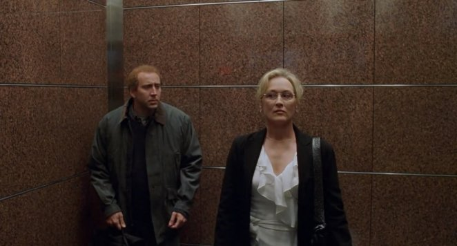 Charlie cannot pluck up the courage to speak to Orlean when they are in an elevator together