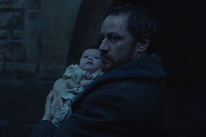 Lord Asriel holds baby Lyra, and looks suspiciously over his shoulder.