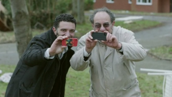 Two men have smartphones in their hands in Black Mirror White Bear