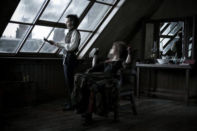 Mrs Lovett lounges in Todd's barber chair, while Todd broods out the window