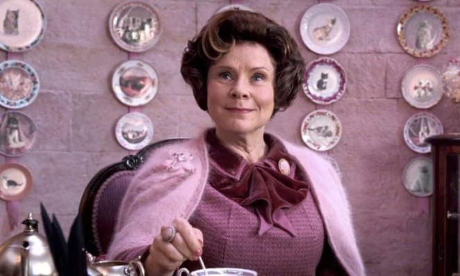 Imelda Staunton as her Harry Potter character wearing pink and stirring tea