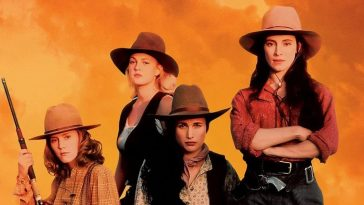 "The women of Bad Girls pose with their guns in a stereotypical ""cowboy"" stance."