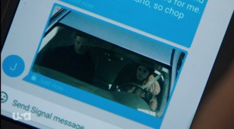 Darlene and Elliot as she drives, from the perspective of a traffic light camera