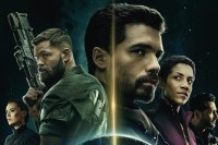 Holden is surrounded by other characters in a promo for The Expanse