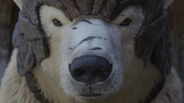 Close-up shot of Iorek, his muzzle scarred, wearing his armour