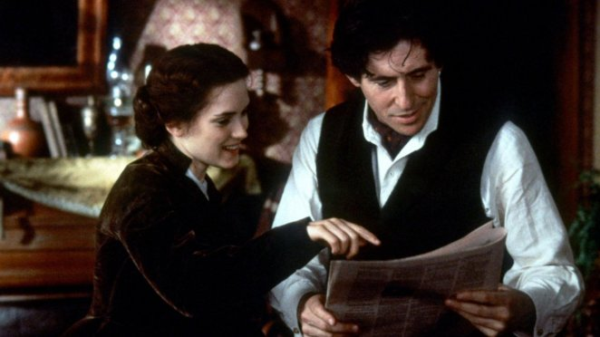 Jo (Winona Ryder) points to part of her newspaper article as Friedrich (Gabriel Byrne) reads it.