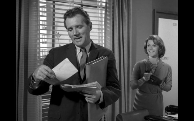 Arthur looks at his mail while talking to his secretary Gail