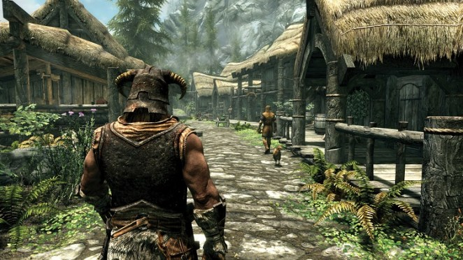 Skyrim's lush visuals of a small town surrounded by trees and mountains. You follow your customized character from behind their shoulder.