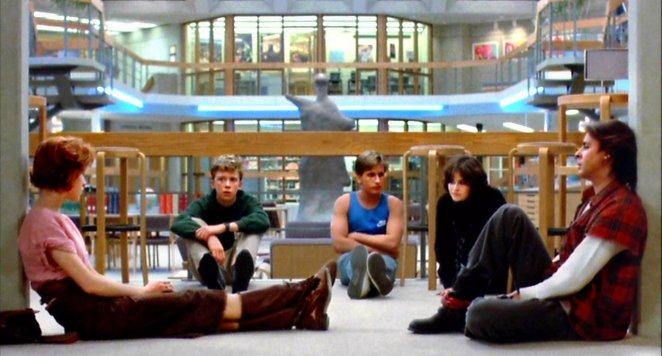 Claire, Andrew, Allison, Brian and John open up to each other while sitting in the school library