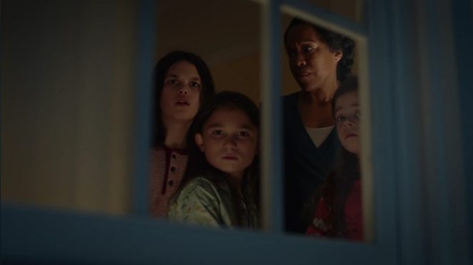 Watchmen - Angela and the three kids look out of their bedroom window in surprise