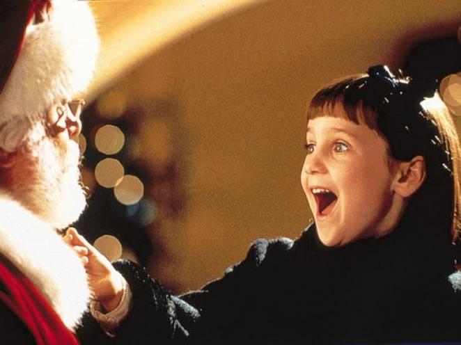 Susan pulls Santa's beard and squeals