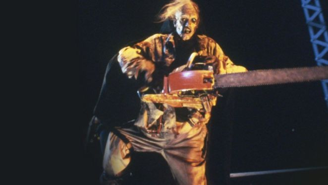 Leatherface wearing the dead body of the hitchhiker and revving his chainsaw