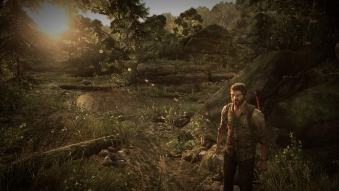 Joel stands in a lush forest environment as the sun sets.