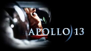 promotional image of the apollo 13 movie. Tom hanks looking to the side through his space helmet