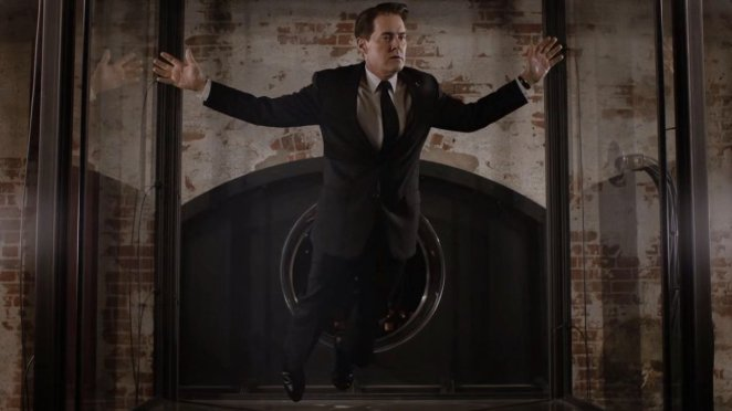 Dale Cooper floats suspended in a giant glass box