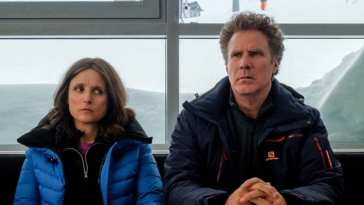 Billie and Pete sit in an office surrounded by snow, looking displeased at a situation