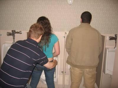 girl peeing in toilet