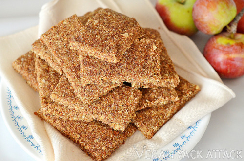 """Raw Apple Cinnamon Almond Bars<br /> After making a few raw desserts, I've come to find out that I am in love with the crusts. They are so simple, usually made up of only dates and raw almonds, but I wanted to take it a step further and create breakfast/snack bars out of them! So, for this week's Raw Wednesday feature I decided to elaborate on the ol' date and almond combo and add in some seasonal warmth and produce.</p> <p>Ingredients (makes 12-15 servings)<br /> 2 Cups Raw Almonds, Soaked for 4 hours<br /> 11/2 Cups Dates, Pitted & Soaked for an hour or more<br /> 3/4 Cup Date Soaking Water<br /> 1/3 Cup Ground Flaxseed<br /> 1 Tbsp. Raw Agave Nectar<br /> 2 tsp. Ground Cinnamon<br /> 1 Cup Apple, diced<br /> Directions:<br /> Drain water from almonds and dates, but save the date water. Place almonds, dates, ground flaxseed, date water, cinnamon, and agave into a food processor; pulse until the almonds are in tiny pieces, but are not creamy. Add in diced apple and pulse until the apple pieces are a little smaller and combined well with the almond mixture.<br /> Spread the mixture on one or two Paraflex dehydrator (depending on the size) sheets, about 1/4-1/2"""" high. Slice into desired-sized pieces and dehydrate overnight, or roughly 9 hours, at 110F. After that, pull the pieces carefully off of the sheet and turn them over onto just the mesh screen; dehydrate for another 10 hours at 105F.<br /> Take them out of the dehydrator and store them in your refrigerator. Mine are in a tupperware container with a moisture absorbing packet so that they last a little longer."""