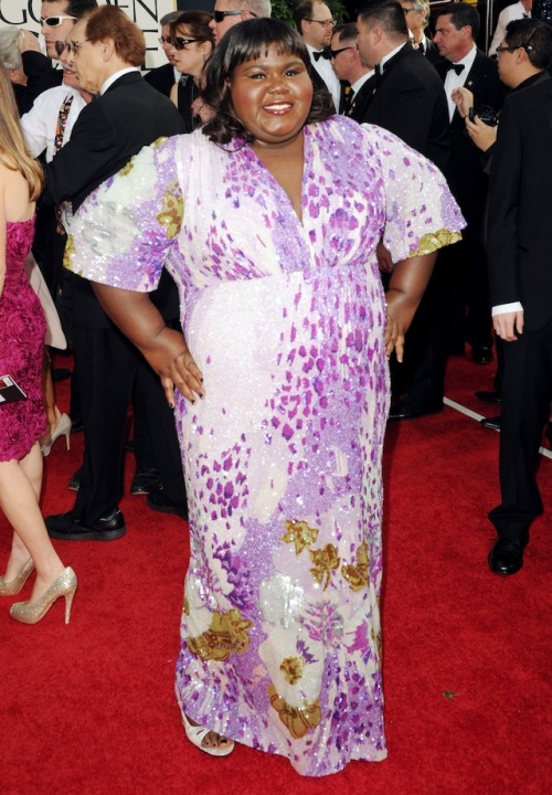 As much as I adore Gabby Sidibe, This dress is just not working for me. The shape is great for her figure, the color is flattering to her skin-tone, but the print is tacky.