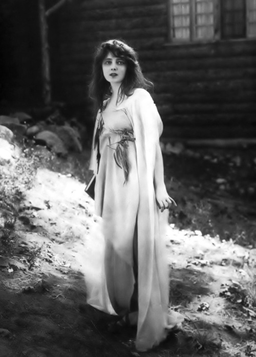"theloudestvoice:Marie Doro as Daphne in The Wood Nymph, 1916  Summary: ""Daphne, raised in the redwood forests of  		California by her reclusive mother, has never seen a man.  Having  		learned of the Greek gods, Daphne mistakes the first man she sees, a  		hunter named William Jones, for Apollo.  Another young man, Fred  		Arnold, also stumbles upon Daphne, and the two men become friendly  		rivals for her attentions. When tramps set the forest afire, William  		fails in his attempt to rescue Daphne, who is found by Fred when she  		wanders near the men's camp.  Fred's father, David Arnold, finds  		and saves Daphne's mother, only to discover that she is his  		long-departed wife and that Daphne and Fred are brother and sister.   		Husband and wife are reconciled, and William and Daphne are united."""
