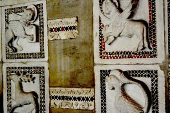 Engraved artwork around the courtyard walls