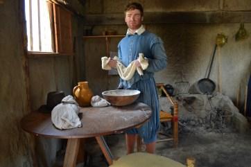 Pilgrim sifting corn