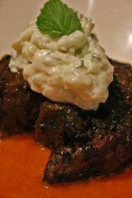 blackened flank steak with tizziki (cucumber yogurt) on tomato vodka sauce