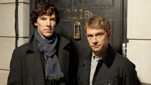 Sherlock (Benedict Cumberbatch) and John (Martin Freeman) outside 221b Baker Street in BBC One's Sherlock.