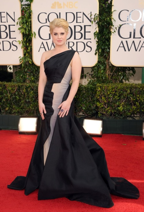 I have no idea what Kelly Osbourne is doing at the Golden Globes, but hey when your dad's a rock star I guess you can get away with all kinds of shit. That being said, I like her dress.