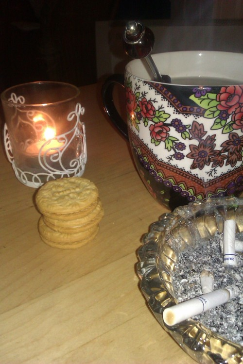Candles, tea, a smoke, some biscuits and music playing in the background. A little bit of happiness<3