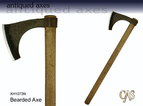 When people think of Viking age weapons, they usually think first of the battle axe, and the image that forms in their mind is a massive weapon that only a troll could wield. In reality, battle axes in the Viking age were light, fast, and well balanced, and were good for speedy, deadly attacks, as well as for a variety of nasty tricks.  The axe was often the choice of the poorest man in the Viking age. Even the lowliest farm had to have a wood axe (right) for cutting and splitting wood. In desperation, a poor man could pick up the farm axe and use it in a fight. Axes meant for battle were designed a bit differently than farm axes. The photo to the left shows two reproduction axes based on 10thcentury finds, while the photo on the right shows a historic 10thcentury axe head. Axe heads were made of iron and were single edged. A wide variety of axe head shapes were used in the Viking age. The sketch to the right shows three different 11thcentury axe heads, while the photo to the left shows three earlier axe heads. In the early part of the Viking era, the cutting edge was generally 7 to 15cm (3-6in) long, while later, axes became much larger. The cutting edge of the largest of the axe heads shown to the right is 22cm (9in) long. The edge of this axe is made of hardened steel welded to the iron head. The join line is clearly visible in the sketch and in the historical axe head. The steel permitted the axe to hold a better edge than iron would have allowed. Some axe heads were elaborately decorated with inlays of precious metals, notably the Mammen axe head. The head is decorated on every flat surface with inlays of gold and silver and was found in a rich grave that dates from the year 971.