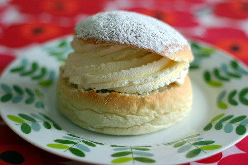 The Swedish Semla - Recipe    75 g butter 1 cup milk 25 g yeast 1 pinch salt 10 teaspoons sugar 3 cups wheat flour 1 teaspoon cardamom, ground	 (optional) 1/2 cup egg, beaten  Filling  300 g almond paste 1/2 cup milk 1 1/2 cups double cream confectioners' sugar Change Measurements: US | Metric  Directions: Prep Time:  1 hr Total Time:  2 1/2 hrs   1 Melt the butter in a saucepan, pour in the milk och warm until lukewarm (99 F).   2 Crumble the yeast in a bowl and stir in a little of the warm butter/milk until the yeast is completely dissolved.   3 Add the rest of the butter/milk, salt, sugar, cardamom and most of the flour (save some for the rest of the baking). Work the dough smooth and shiny. It should let go from the edges of the bowl. Allow the dough to rise under a baking cloth for 40 minutes.   4 Sprinkle flour over a baking board and place the dough there. Make 1 bun per person by rolling the dough against the baking board in your cupped hand.   5 Put the buns on a baking tray with oven paper and allow them to rise for an additional 30 minutes. Preheat the oven to 440°F.   6 Brush the buns with the beaten egg and bake them for about 10 minutes in the middle of the oven. Let them cool on an oven rack under a baking cloth.   7 Cut of a cover on each bun. Take out a part of the crumb and put it in a bowl. Crumble in almond paste, mix and dilute with the milk to a rather soft mixture.   8 Distribute the filling in the buns. Whip the cream and put a large dollop in every bun.   9 Put the cover on and sift some confectioners? sugar over ?semlorna?  Read more: http://www.food.com/recipe/swedish-semlor-131318#ixzz1H3K88wvs