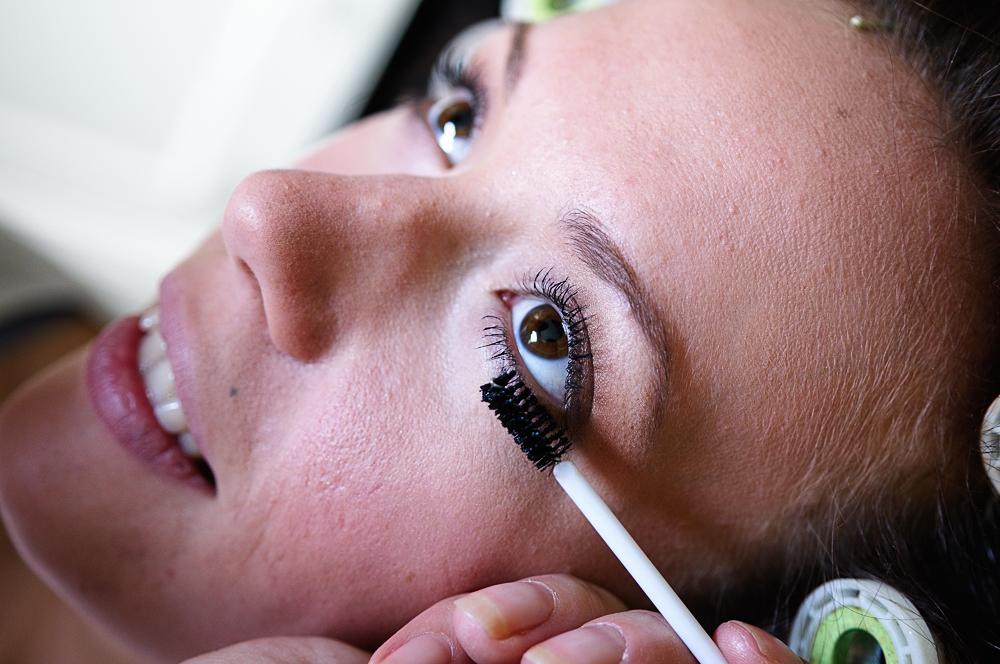 Mascara before false lashes.