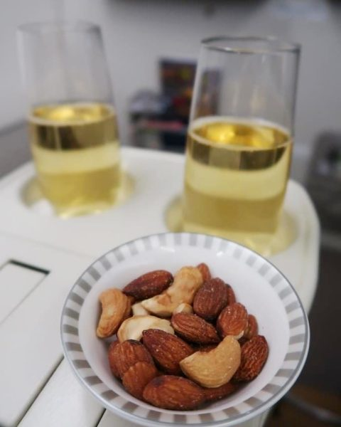 Charles Heidsieck Champagne and warmed nuts greeted us aboard the Singapore Airlines Business Class Flight