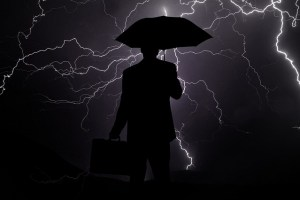 A business person weathering the storm