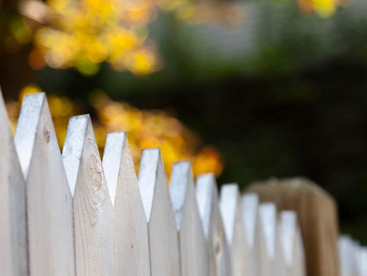 Closeup of white picket fence
