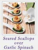 Seared Scallops over Garlic Spinach