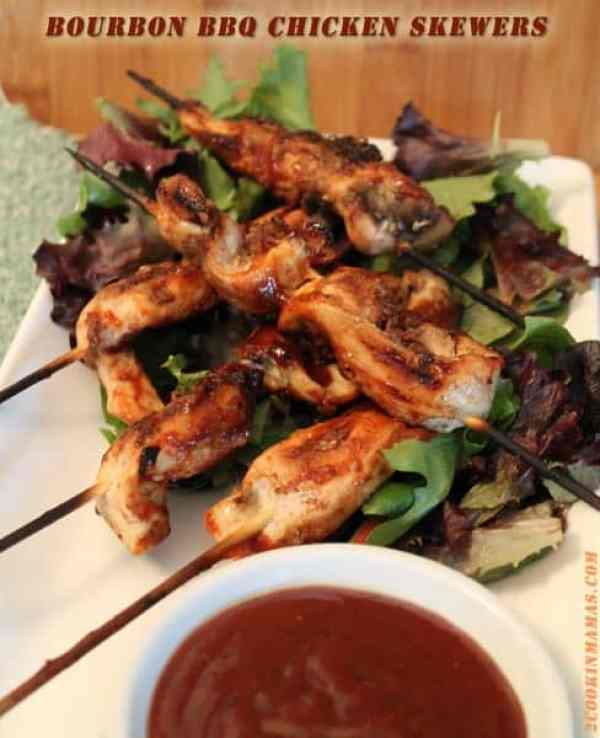 Bourbon BBQ Chicken Skewers | 2CookinMamas Chicken is brought to a whole new level when smeared with bacon paste and grilled. These bourbon BBQ chicken skewers are served with a side of bourbon BBQ sauce that is out of this world. #recipe