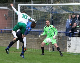 Keiron uses his strength to prevent a goal scoring opportunity for Bognor
