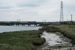 90007 'Sir John Betjeman' crosses the Stour Estuary