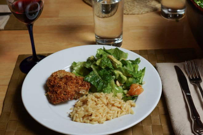 Baked chicken thighs with a salad and cheezy orzo.