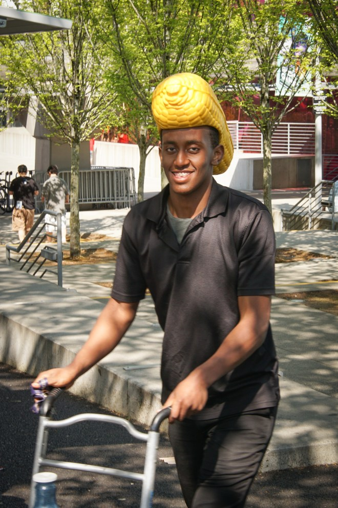 Young man working at the corn-on-the-cob cart at the Seattle Center
