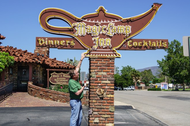 Howard rubbing the giant  Aladdin's magic lamp in Rancho Cucamonga, Caifornia