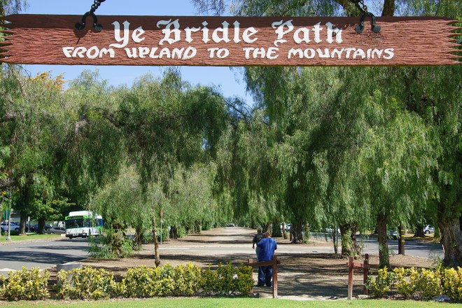 Sign over a path leading to the mountains  in Upland California